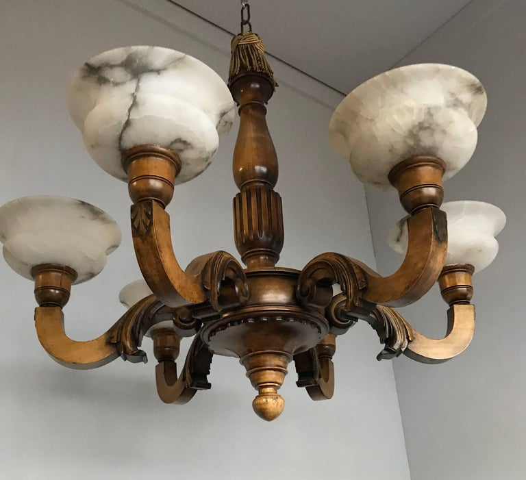 European Early 1900s Six Light Quality Carved Wood Chandelier with Alabaster Shades For Sale