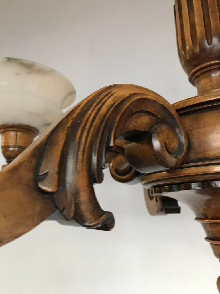Early 1900s Six Light Quality Carved Wood Chandelier with Alabaster Shades In Excellent Condition For Sale In Lisse, NL
