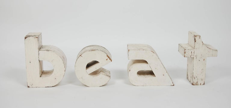 1960s vintage wooden signage from a record store. Distressed thick plywood letters that where originally painted white. The stylized font was cutting edge during this time period.