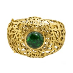 Chanel Gold Tone Filigree Cuff With Emerald Green Poured Glass Stone, Early 1980