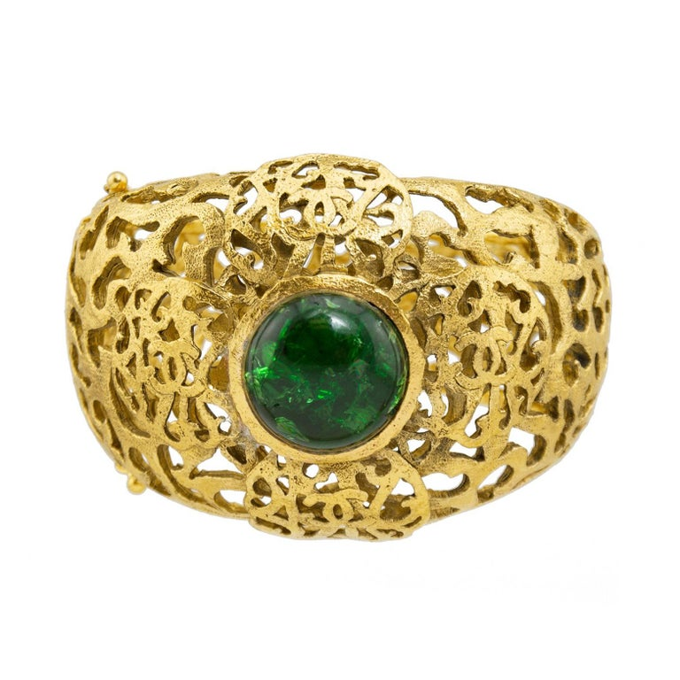 Chanel Gold Tone Filigree Cuff With Emerald Green Poured Glass Stone, Early 1980 For Sale