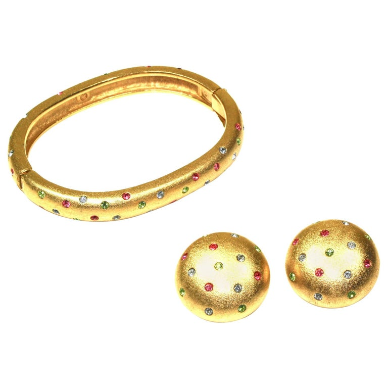 Early 1990's Bangle and Clip Earrings Suite by Swarovski For Sale