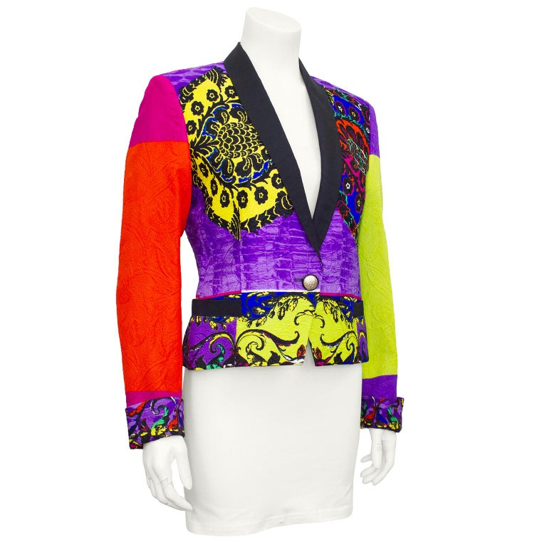 Colourful tuxedo style jacket from Gianni Versace's early 1990's collections. Lime green, purple, yellow, pink and orange colour block brocade with classic Versace Baroque print throughout. Subtle metallic throughout brocade. Black satin label with