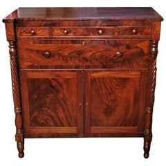 Early 19th Century American Empire Flame Mahogany Cabinet