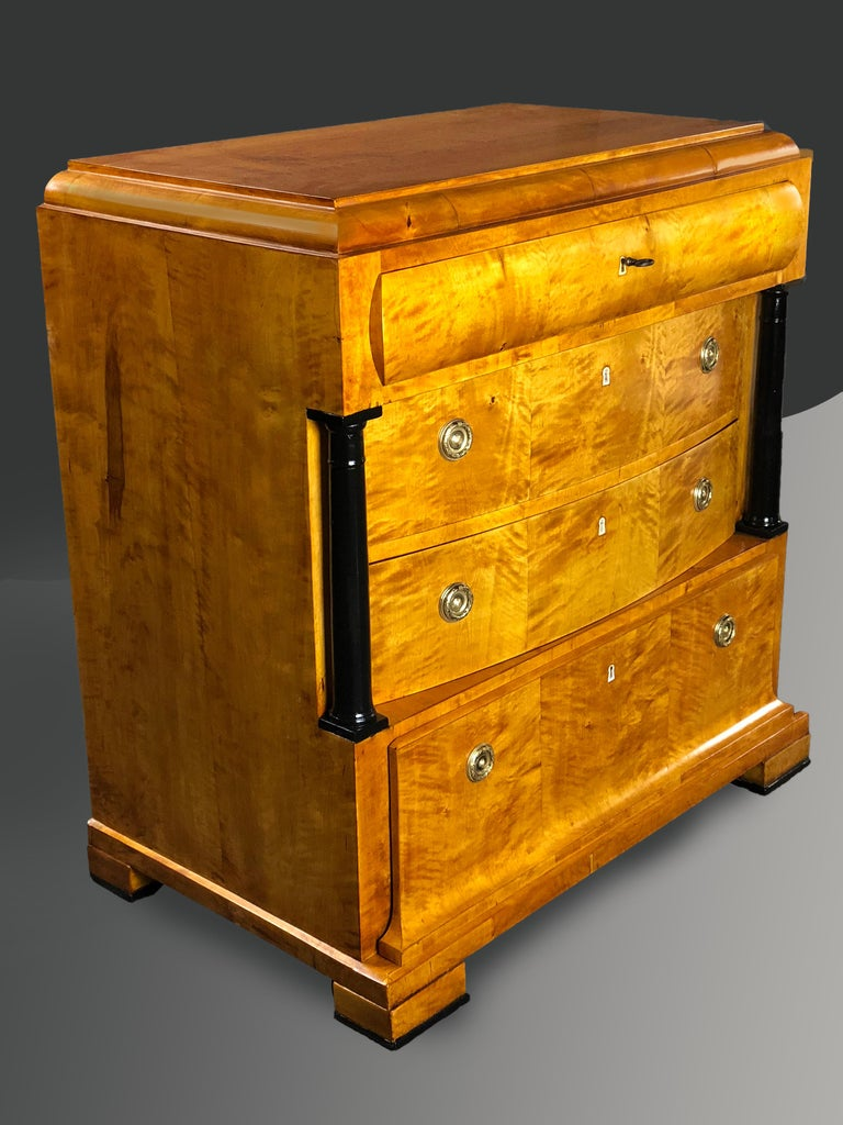 Outstanding Biedermeier late 19th century German finely figured satin birch commode of complex architectural design, the top border ending in curved moulding, the top drawer also having a moulded front, its interior with three divisions. The two bow