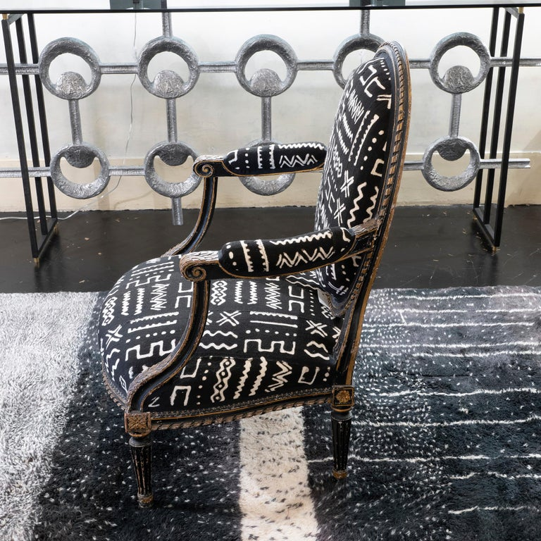 Blackened Early 19th Century Black and Gilded Armchair Black and White Ethnic Fabric For Sale