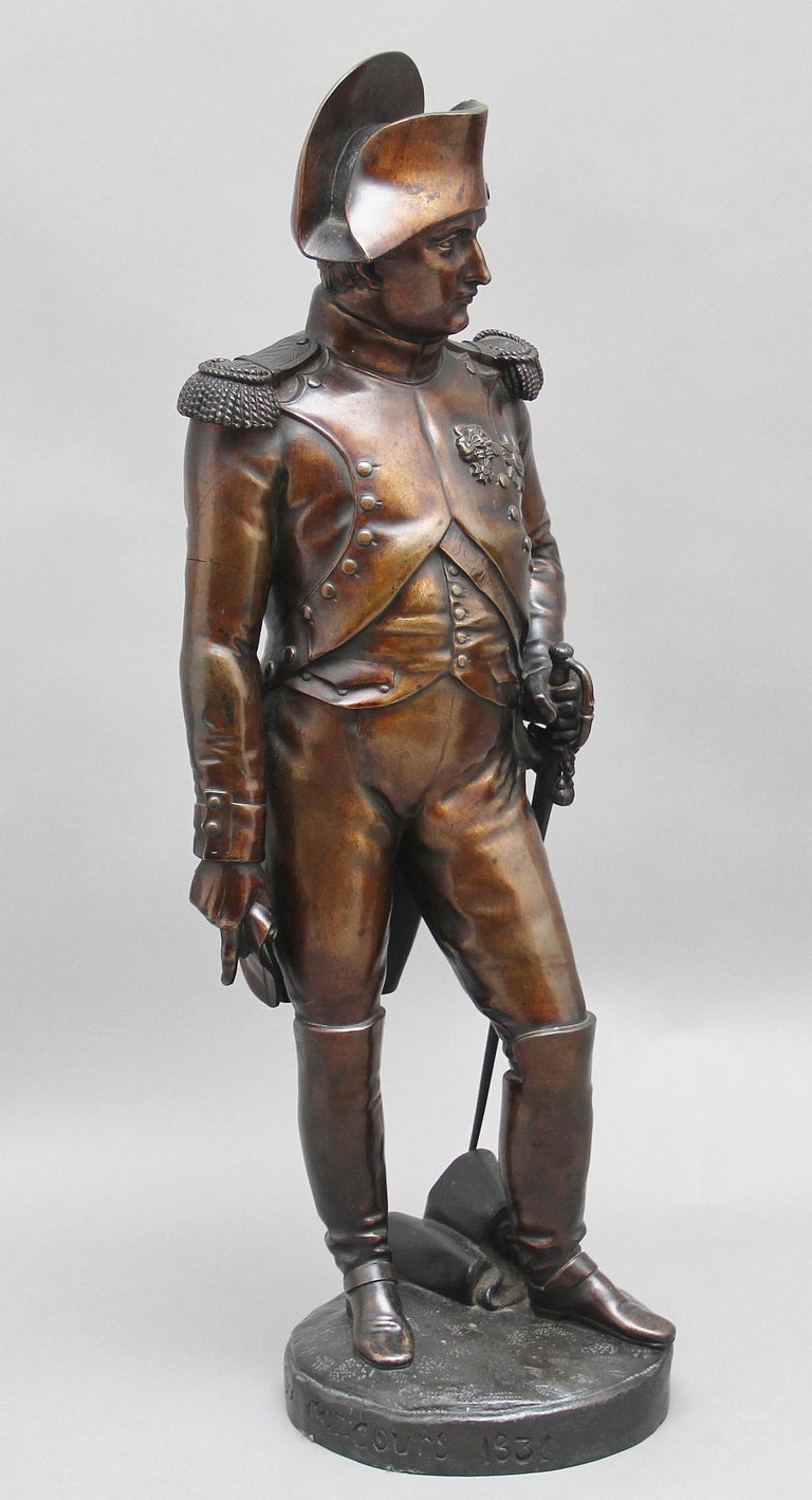 Early 19th century French bronze sculpture of Napoleon Bonaparte by Carle Elshoecht (1797-1856) and is dated and signed 1831.  This bronze has a fabulous patina and is in excellent condition, standing in uniform wearing a bicorn hat, waistcoat and