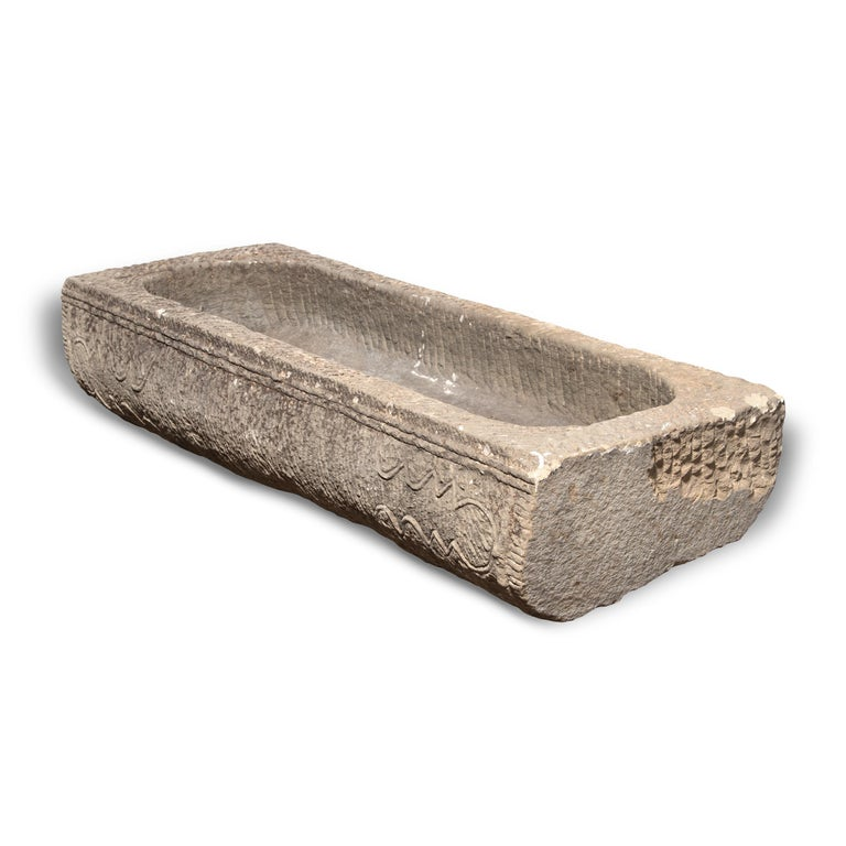 Prized mounts once took refreshment from this stone trough, carved from a solid block of limestone more than one hundred years ago. Once purely functional, the trough is celebrated today for its elegant form, rustic authenticity, and beautifully