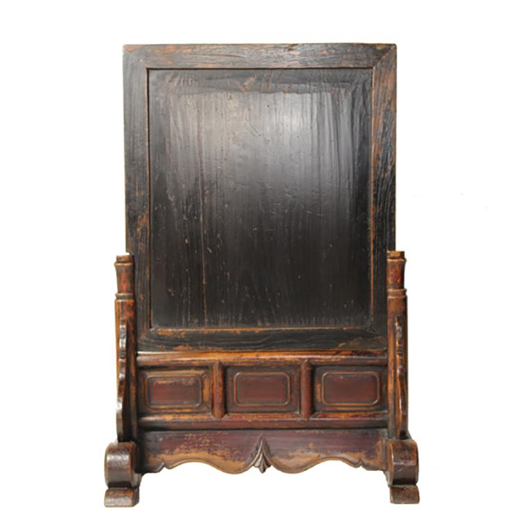 This 19th century spirit screen from northern China is inset with a duan stone, similar to stones used to create many inkstones for calligraphy. The Stand is carved with abstract clouds and auspicious ruyi symbols. Traces of its original dark