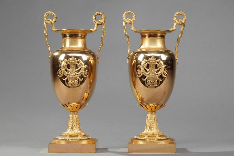 Pair of small krater centerpiece vases crafted entirely from ormolu bronze. A krater was a large vase in Ancient Greece, particularly used for watering down wine. These antique vases feature delicately snake-shaped handles. The paunch is beautifully