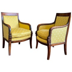 Early 19th Century Empire Mahogany Fauteuils Bergères Aux Dauphins, circa 1830