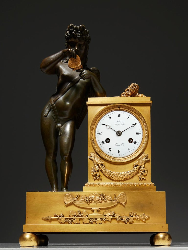 Gilt Early 19th Century Empire Mantel Clock by Ledure with Apollo or Eros For Sale