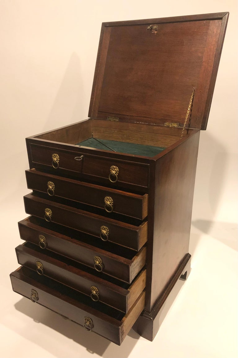 Early 19th century English Regency mahogany specimen chest of six drawers with lion head pulls. Drawers and top compartment are lined with green felt. Top opens and contains the drawer locking pin.