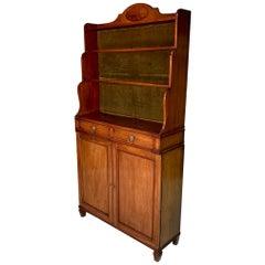 Early 19th century English Regency waterfall bookcase cabinet in mahogany