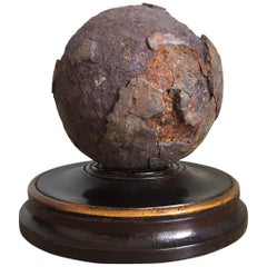 Early 19th Century English Relic Cannonball on a Turned Wooden Base