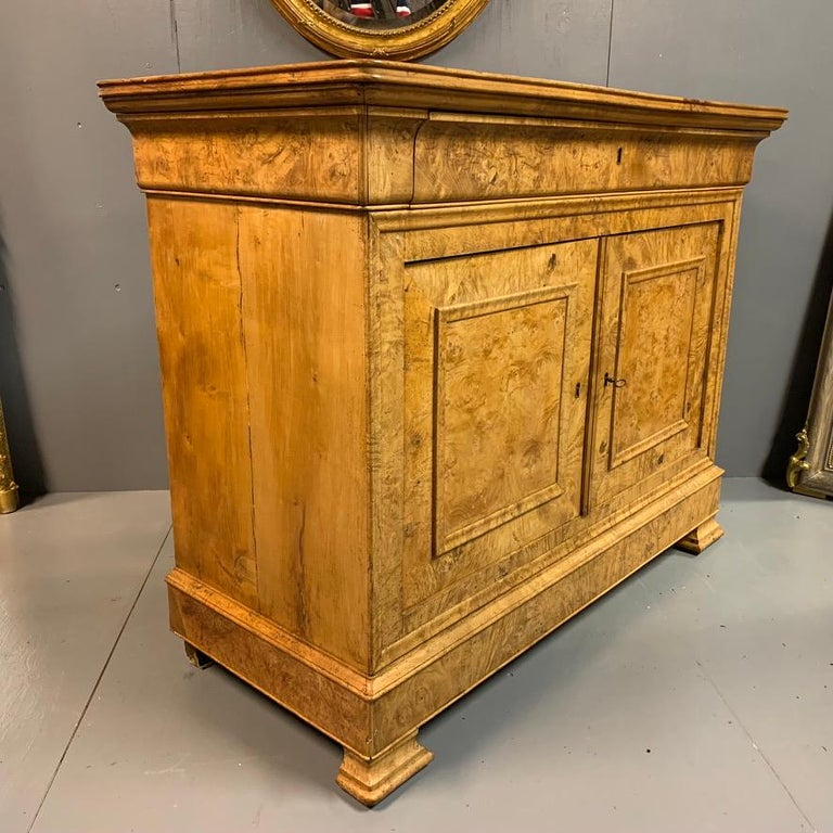 A really unusual and very decorative French burr ash buffet sideboard with a full width frieze drawer and large two-door cupboard space.