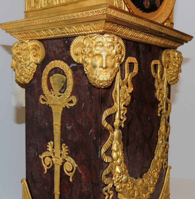 Gilt Early 19th Century French Empire, Rouge Marble Dore Bronze Mounted Figural Clock