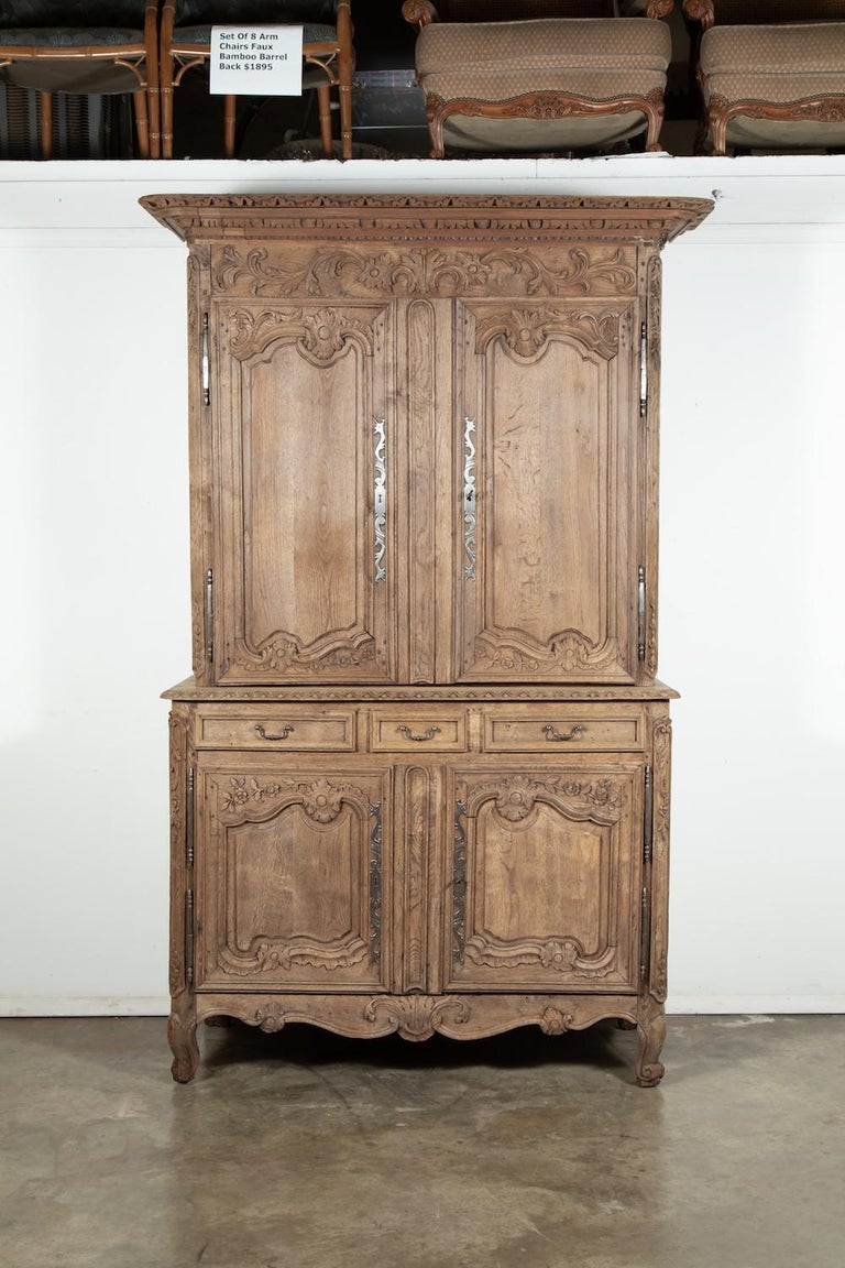 Beautiful 19th century country French Louis XV washed oak buffet deux corps handcrafted by talented artisans of Mont Saint-Michel, an island commune in Normandy. Expertly crafted and sculpted in select French oak, this piece features an upper