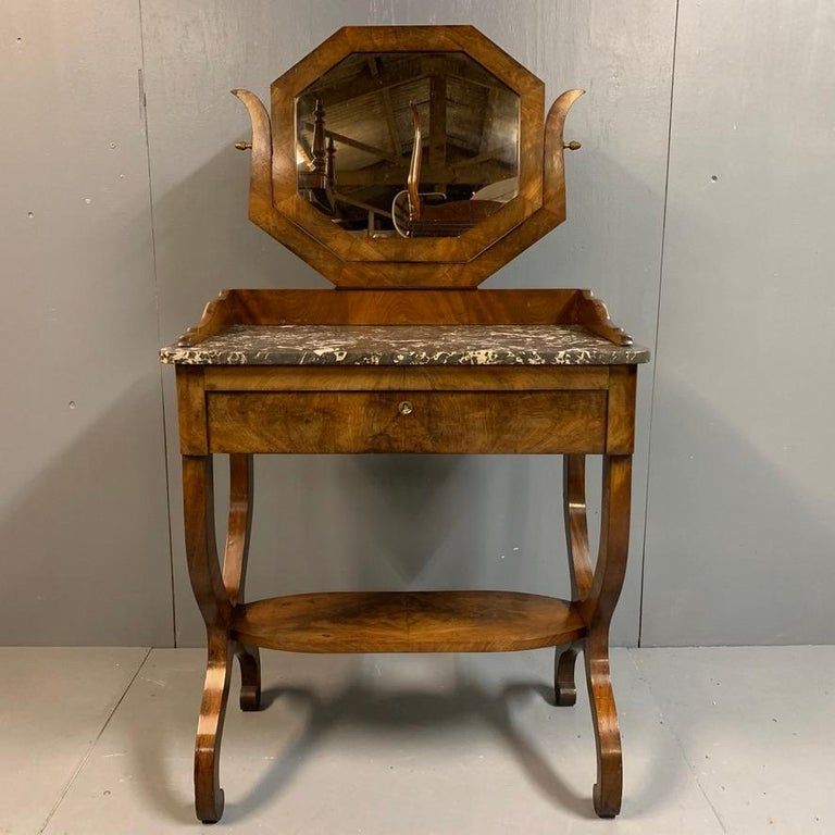Lovely quality and very decorative French Regency dressing table in mahogany with its original marble top and octagonal mirror, also a full width frieze drawer, circa 1820. This is a very practical size for comfortable, everyday use and give you