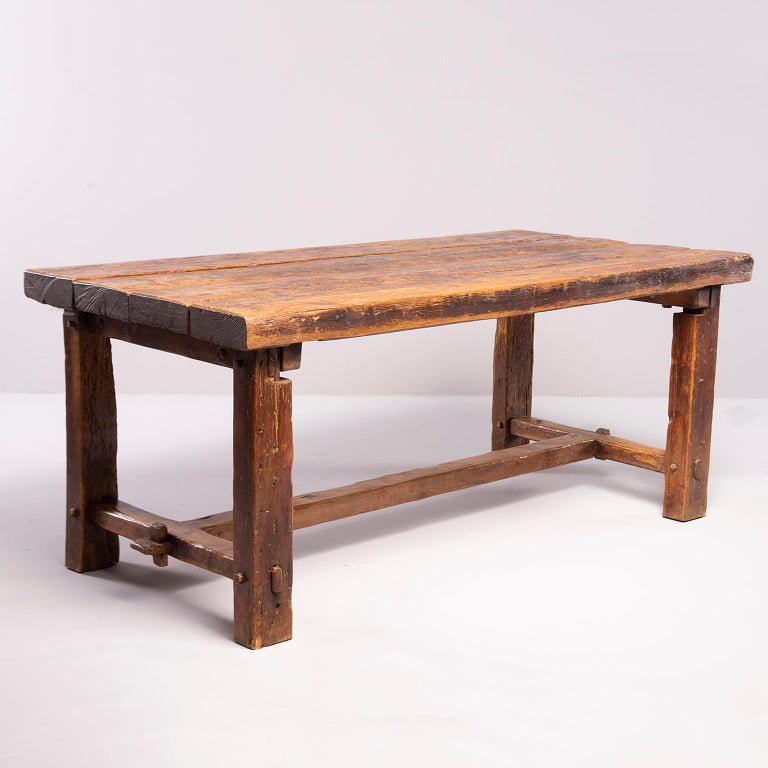 Early 19th century rustic oak table with mortise and tenon construction found in France. Four plank top. Great patina and wear.