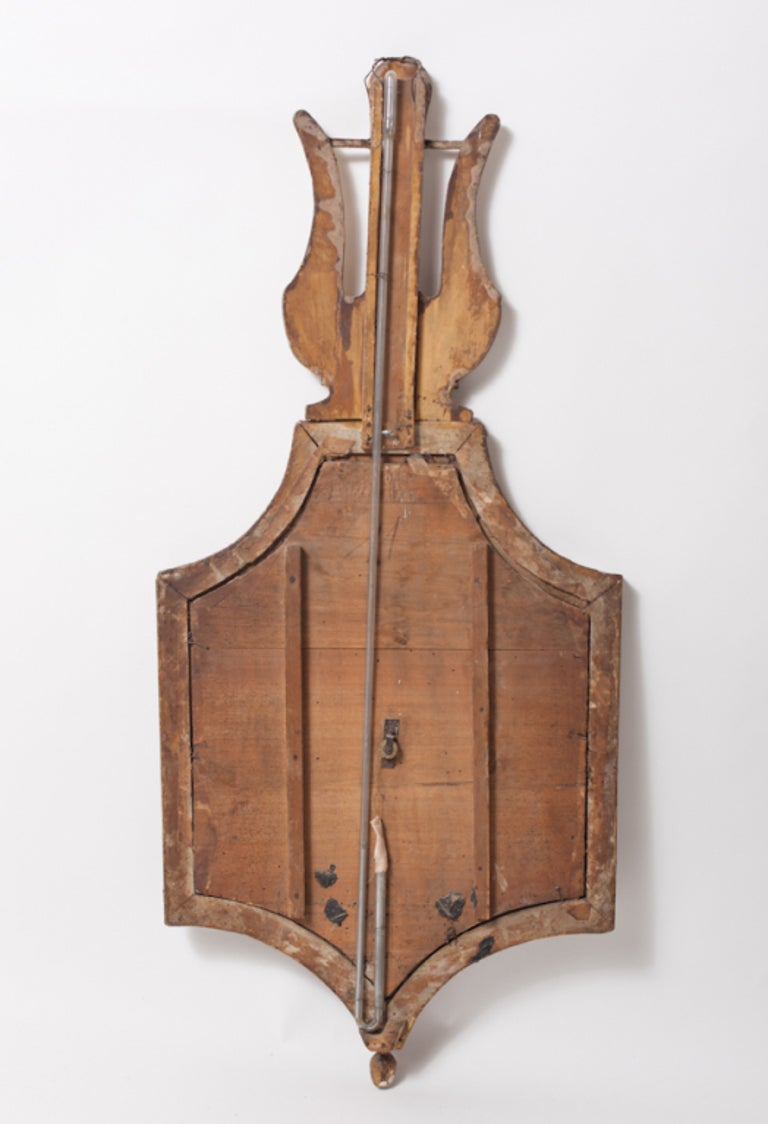 Barometer end of the 18th century, Directorie, in carved and gilded wood, by Selon Toriceli, with allegory music wing on the top, beautiful patina, and decorative barometer with mechanism, but is not in working order.