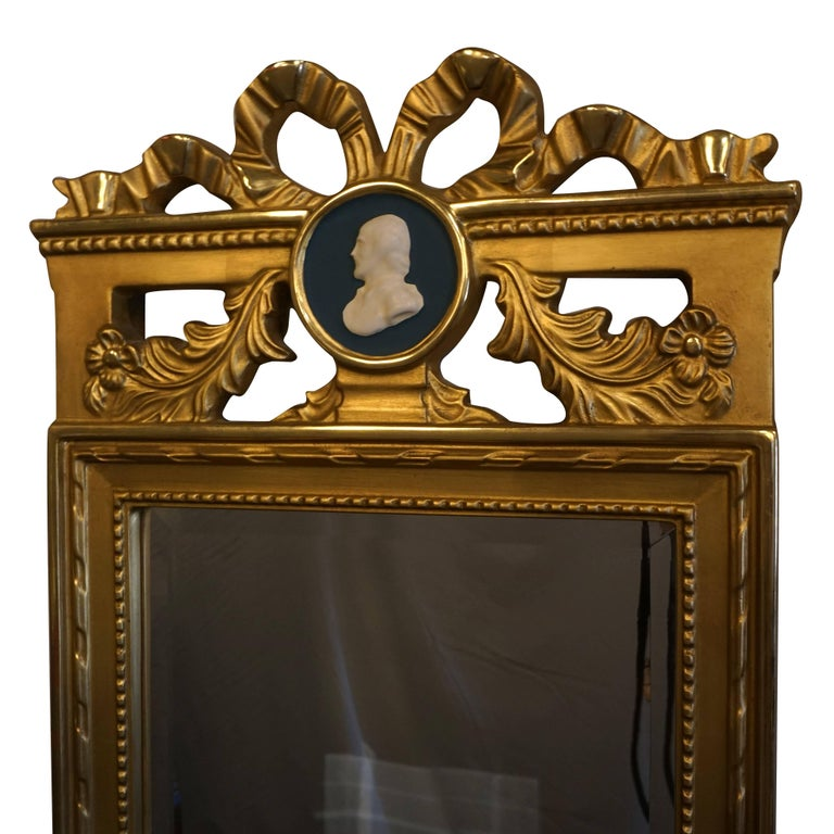 A 19th century Gustavian wooden mirror with original gilded finish and centered medallion from Sweden., Scandinavia.