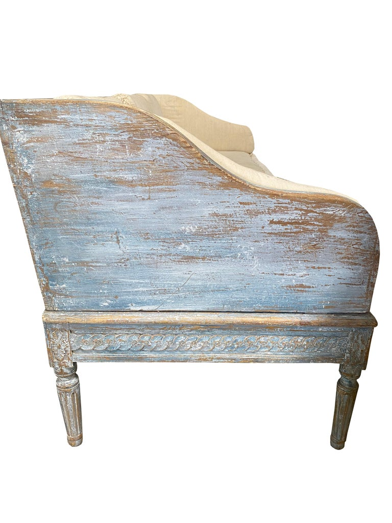 Swedish Simplicity at its best. This early 19th century Swedish Gustavian sofa is classic yet modern. It has the perfect Swedish simple curves and straight lines. The paint is original with touch ups and is the palest of blues with white hues. In