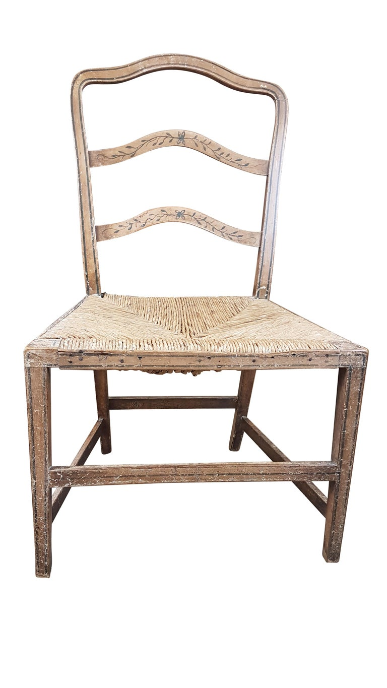A very nice and rare early 19th century Georgian rush seated chair in original painted finish. The rush seat is in great condition and is the original seat, the painted finish whilst being scratched marked and worn is the original and the line and