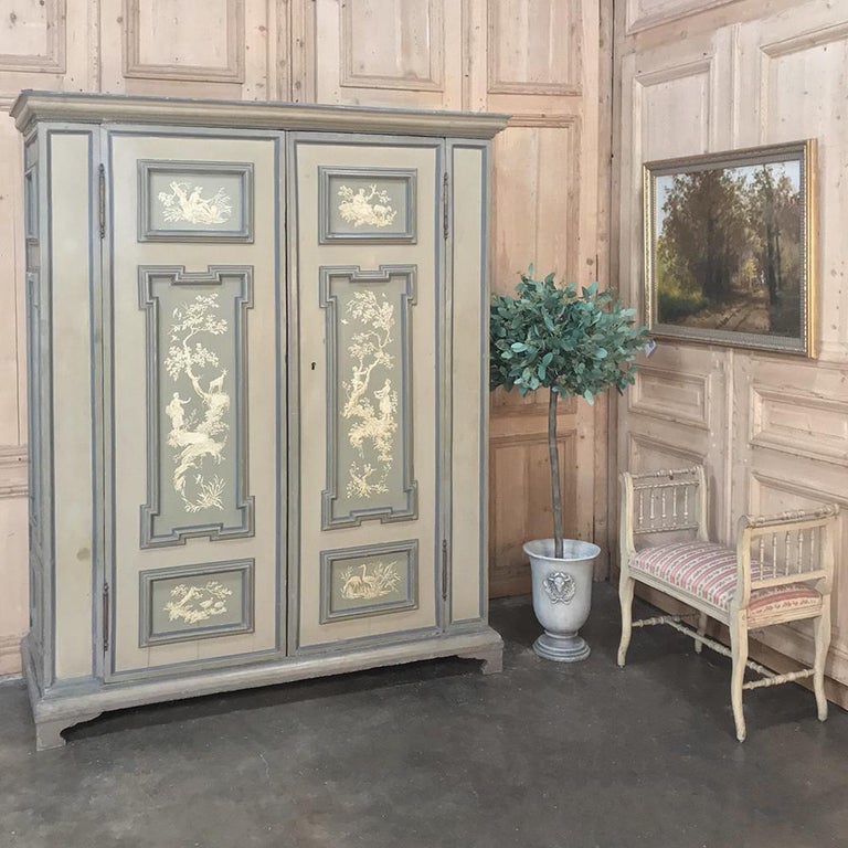 Early 19th century Italian neoclassical painted armoire represents the epitome of master Italian craftsmanship and artistry melded into one instant family heirloom! First, the rectilinear classical architecture is immediately arresting when one