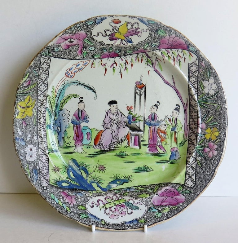 This Ironstone pottery dinner plate was made by the Mason's factory at Lane Delph, Staffordshire, England and is decorated in the Chinese Scroll Pattern, fully stamped and dating to the earliest period of Mason's Ironstone production, circa