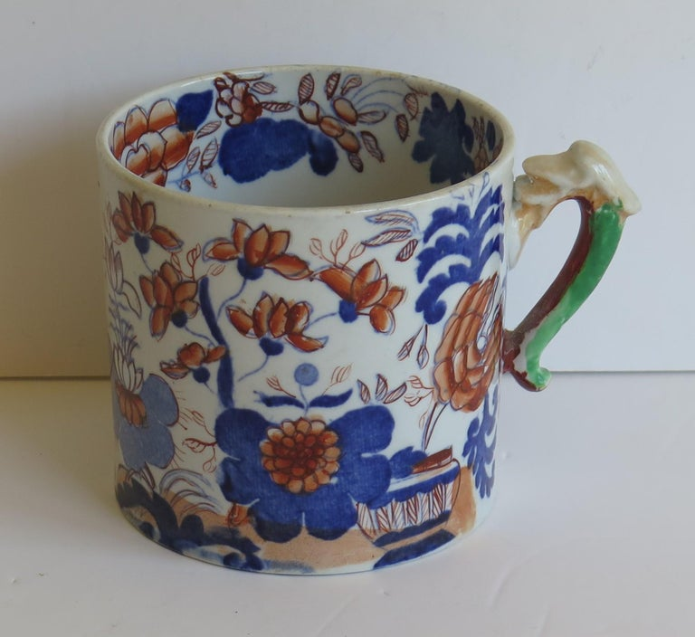 This is a good Ironstone pottery mug made by the English factory of Mason's Ironstone, fully marked and dating to the early 19th century, circa 1825.  Early Mason's mugs tend to be fairly rare and hard to find.  The mug is cylindrical with