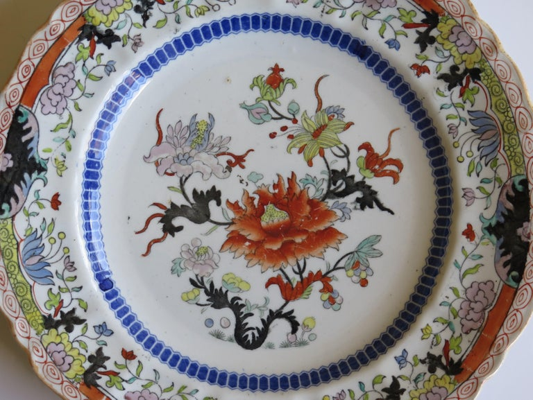 This Ironstone pottery large dinner plate was made by the Mason's factory at Lane Delph, Staffordshire, England and is decorated in the Ragged Rose Pattern, fully stamped and dating to the 19th Century, Circa 1830   This is a rare pattern.  The