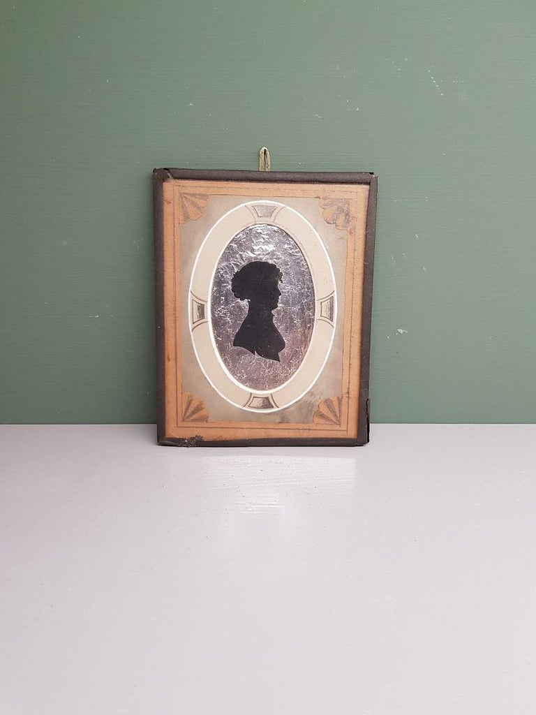 European Early 19th Century Miniature Silhouette of a Lady on a Silver Paper Background For Sale