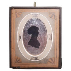 Early 19th Century Miniature Silhouette of a Lady on a Silver Paper Background