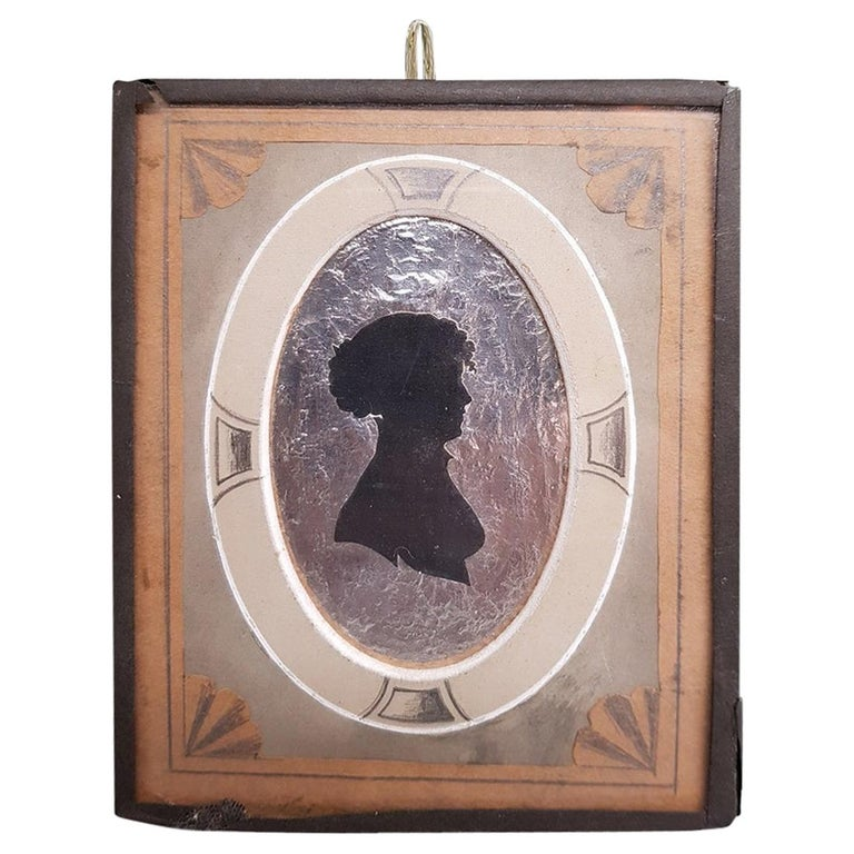 Early 19th Century Miniature Silhouette of a Lady on a Silver Paper Background For Sale