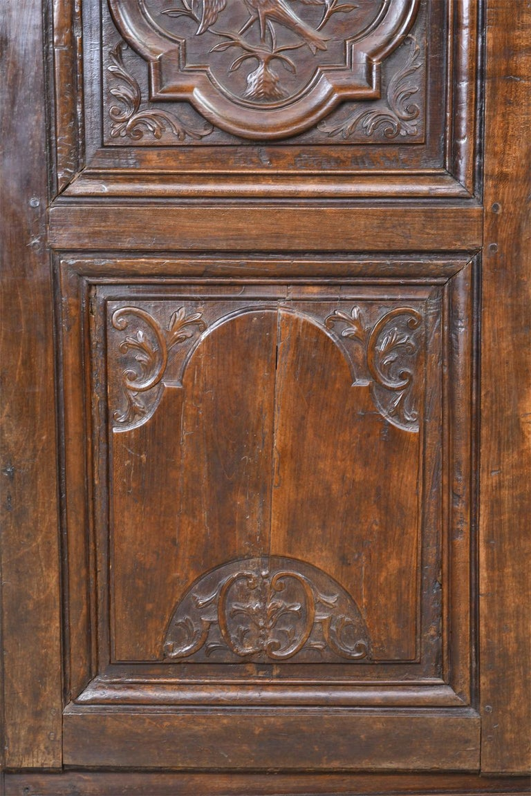 Walnut Early 19th Century Narrow French Bonnetiere or Cupboard with Carved Birds For Sale