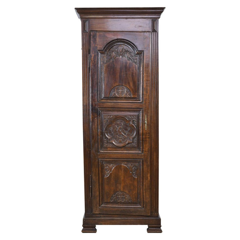 Early 19th Century Narrow French Bonnetiere or Cupboard with Carved Birds For Sale
