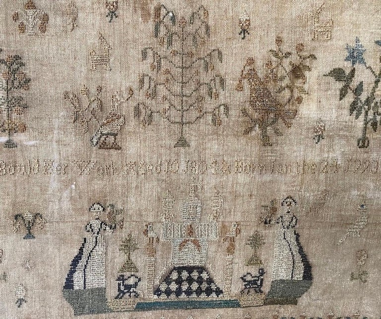 A young girl's hand-done sampler, of silk thread on linen ground. It is decorated in floral, meandering borders surrounding an open background, with various floating bird and animal figures amongst trees and flowering plants. Placed at the