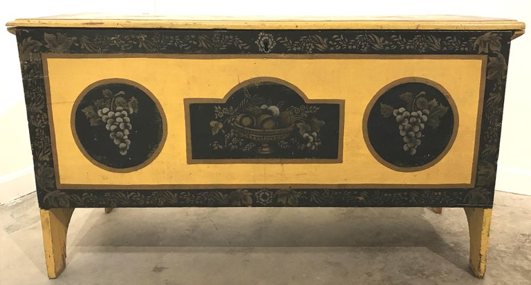 A striking early 19th century New England paint decorated pine blanket chest with snipe hinges and bootjack ends and fitted with an interior till. Paint and stenciled decoration of a later date (probably late 19th century). Very good overall