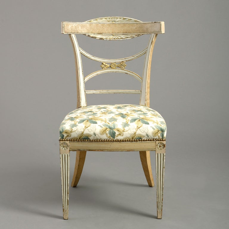 A fine early 19th century Gustavian period painted side chair in the classical manner, the shaped and tapering back set upon an over-stuffed seat, all raised upon square tapering fluted legs, headed with paterae.