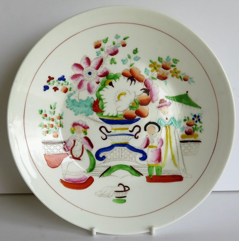 This is a porcelain plate or bowl by the Staffordshire pottery of Hilditch & Son and dating to early in the 19th century, circa 1825.   The charming pattern is called Oriental Musicians and is a Chinoiserie influenced design showing two young