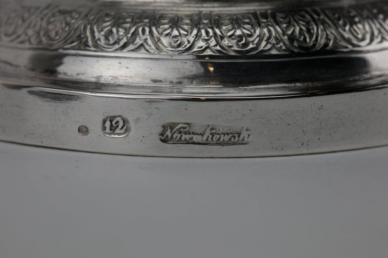 Handmade silver Kiddush goblet, Poland, circa 1820. Large upper portion engraved with curtain decoration, set on a knobbed stem with skirt decoration on a round stylized base. Clearly struck with the quality mark 12 and maker's mark.  Kiddush cup is