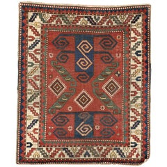 Early 19th Century, Red Field & Ivory Border, Wool Caucasian Pinwheel Kazak Rug