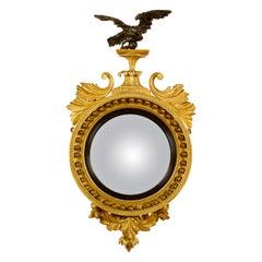 Early 19th Century Regency Eagle Round Gilt and Ebonized Convex Wall Mirror