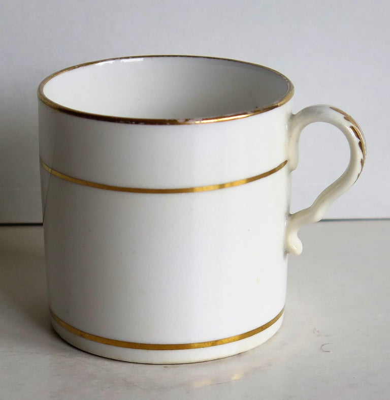 This is a fine example of an English George III, Regency period, porcelain, coffee can (cup), made by Spode in the early 19th century, circa 1810.  The can is nominally straight sided and has the Spode loop handle with a pronounced kick or kink to
