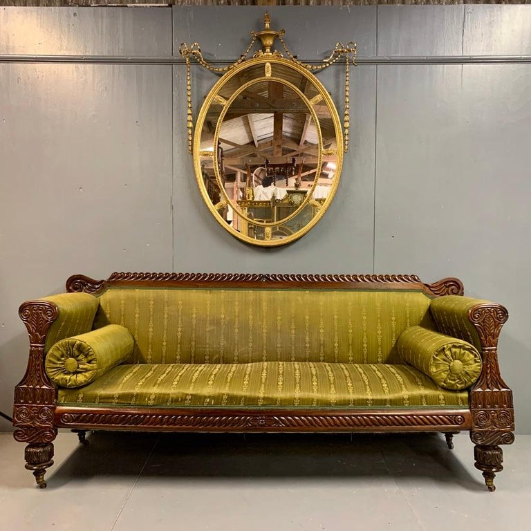 Very beautiful and original late Regency 3-seat sofa in rosewood and beautifully carved. Great proportions to the sofa and it stands very well. Certainly a very decorative sofa, but actually comfortable too which often isn't the case with these