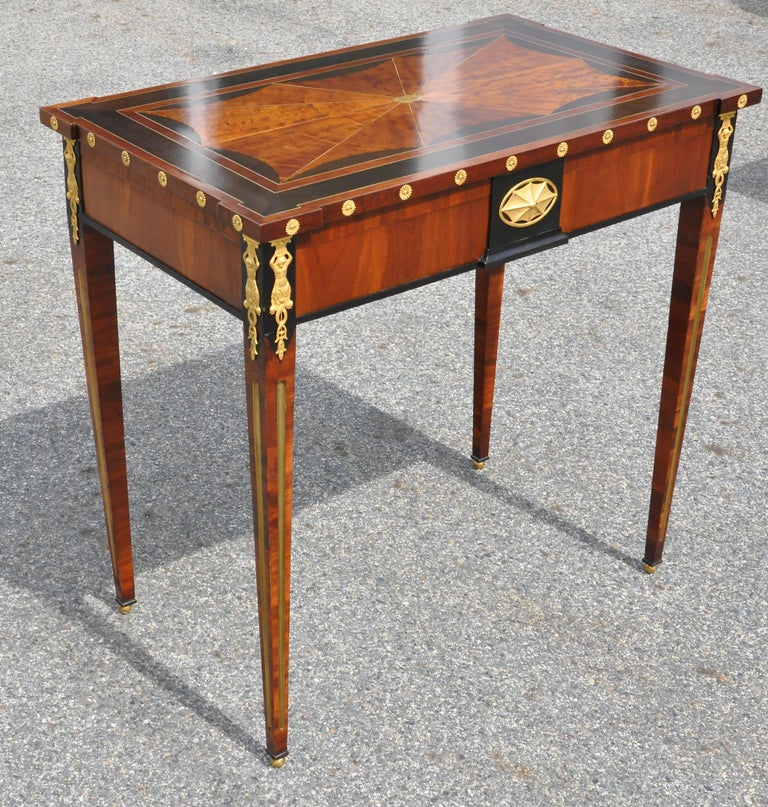 Period Russian neoclassical table with original planter insert. Attributed to Heinrich Gambs. Ebony and figured birch, brass inlay. Top bearing family monogram. Original ormolu mounts. Tables such as this were used as both side or console tables and