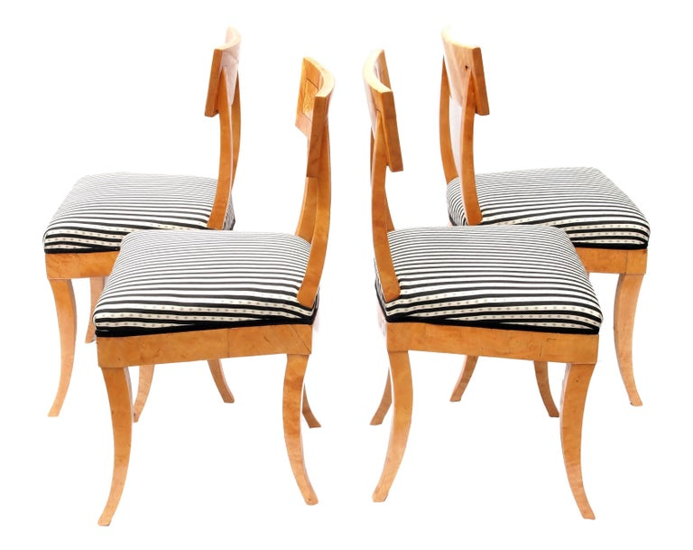 The four chairs date from the Biedermeier period, circa 1820. The chairs are solid and veneered with birch wood. The set is in very good condition. The chairs are newly upholstered according to the traditional style.