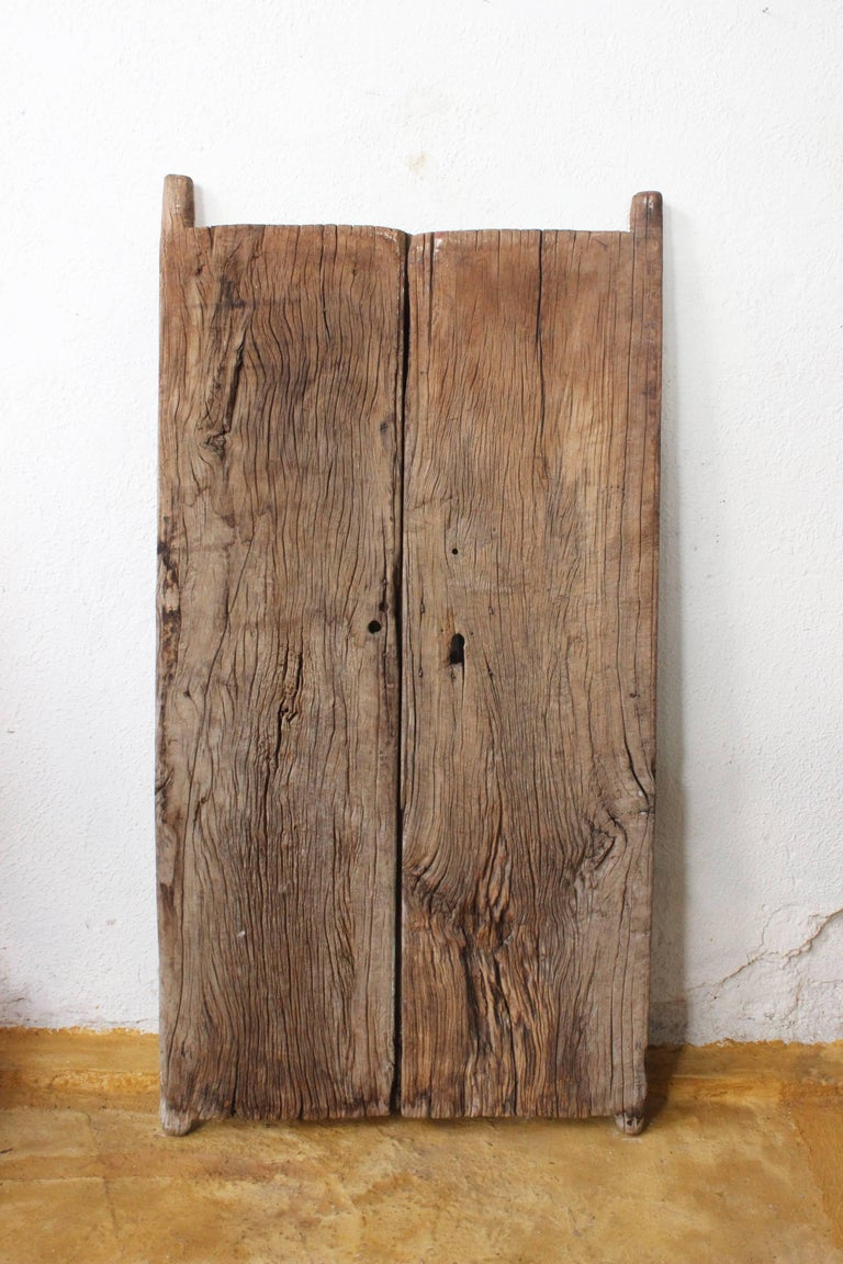This amazing 19th century solid mezquite wood gate is great to give a cozy touch to decoration, both doors are perfectly functional and they have this exquisite patina only given by the passage of centuries.