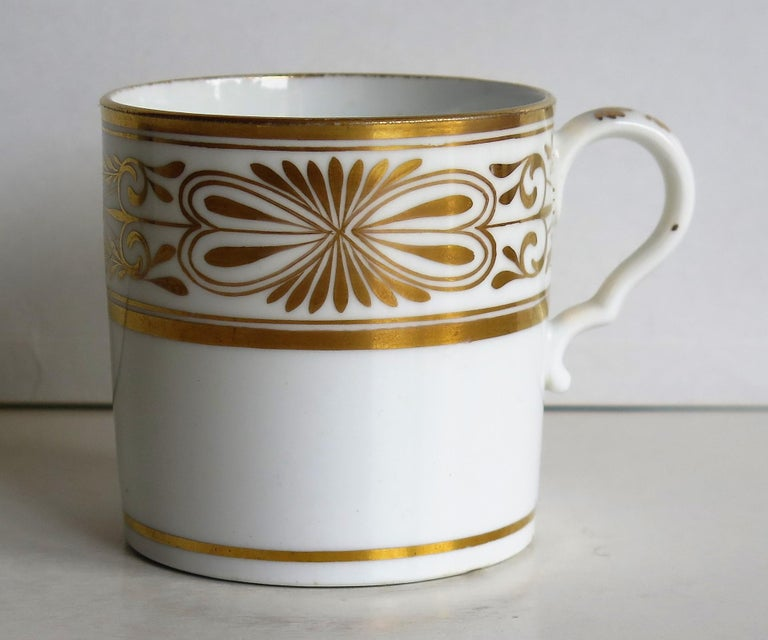 This is a fine example of an English George III period, porcelain, coffee can (cup), made by Spode in the early 19th century, circa 1810.  The can is nominally straight sided and has the Spode loop handle with a pronounced kick or kink to the